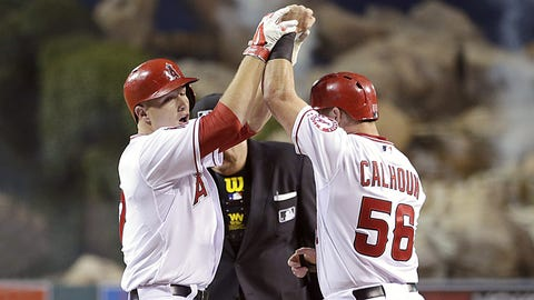 Signs contract extension with Angels, homers in first at-bat
