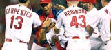 Peralta's walk-off single lifts Cardinals past Reds in 10th