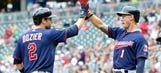 Twins plate double-digits on Tigers again, take DH opener