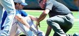 Dodgers ace Kershaw hit in face by soft liner, stays in game