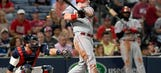Bruce's pair of triples leads Reds to victory over Braves