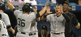 Yankees put brakes on Blue Jays' streak, move back into first