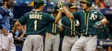 Valencia homers 3 times as A's beat Rays 7-6