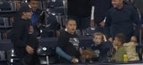 Young fan in full arm cast makes leaping catch on home run ball