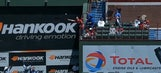Rangers fan dangerously leans over railing to make great catch with hat