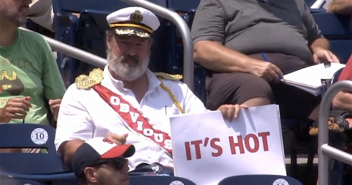 captain obvious holds up comical and very obvious signs at the