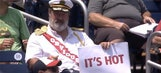 Captain Obvious holds up comical and very obvious signs at the Nationals game