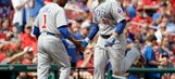 Rizzo's 2 HRs help Cubs beat Cardinals, clinch playoff spot
