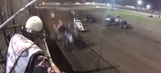 Scary moment: Flagman ducks to avoid flying sprint car (VIDEO)