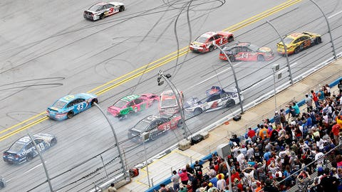 Joey Logano celebrates with a burnout after winning at Talladega to complete the sweep of the three Contender Round races.