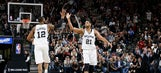 Spurs beat Cavaliers 99-95 for 32nd straight win at home