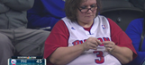 Watch a basketball fan knitting a hat during riveting 76ers-Pistons game