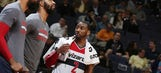 Wall's triple-double leads Wizards over 76ers 99-94