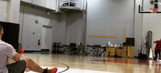 Watch Drake hit a crazy halfcourt shot from his back