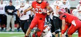 Devontae Booker 'annoyed' by media attention on Harbaugh, Michigan