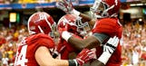 No. 2 Alabama beats West Virginia by committee, 33-23