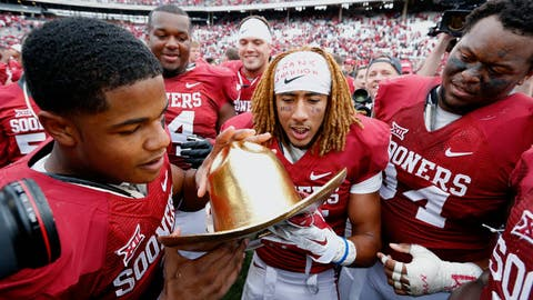 Most unique college football rivalry trophies