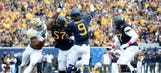 Authorities assess damage from riots sparked by WVU's upset win over Baylor