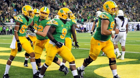 4. Oregon: Green shirt, yellow helmet and pants (retro version)