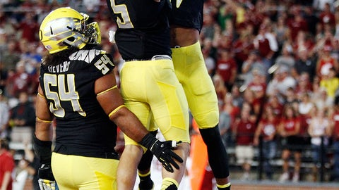 5. Oregon: Black shirt, yellow helmet and pants