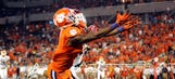 Clemson WR Mike Williams carted off field after hitting goal post