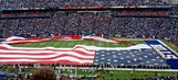Giant American flag rips during national anthem in Buffalo
