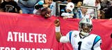 Little Panthers fan, meet big Cam: Ball and fist bump for lucky boy