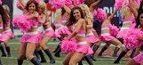 Bring it on! Buccaneers cheerleaders dance in the Vikings' faces