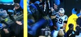 Fan falls out of stands after Luke Kuechly's pick-six touchdown for Panthers