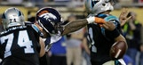 The Latest: Broncos lead Panthers 24-10 late in fourth