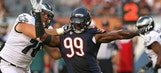 Bears' Lamarr Houston carted off with apparent knee injury