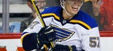 Perron has 3 goals, assist as Blues beat Flames 6-4