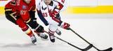 Johansson scores 2 as Capitals beat Flames 3-1