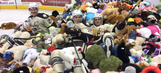 Watch crowd throw more than 20,000 teddy bears onto ice at hockey game