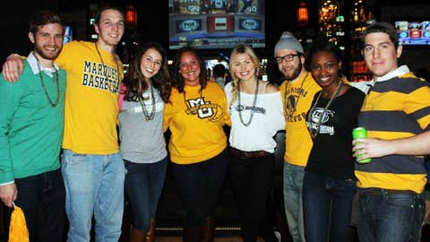 Bishara, Sage and Chyna cheer on the Golden Eagles at a Young Alumni viewing party with some of Marquette's recent grads.