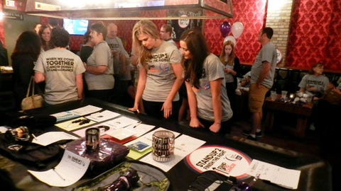 FOX Sports North Girls Kendall and Angie check out the silent auction items up for bid.