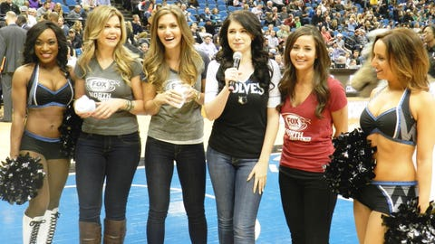 The Timberwolves Dancers put the FOX Sports North Girls to work during a timeout - tossing tshirts out to excited fans.