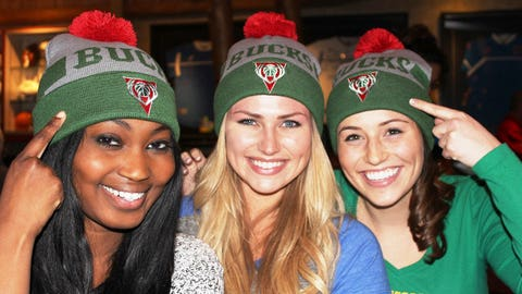 The FOX Sports Wisconsin Girls model the Bucks giveaway item for the 1st 10,000 fans at Saturday's game vs. Portland.