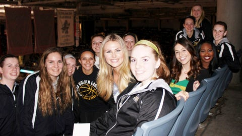 Put me in coach! The FOX Sports Wisconsin Girls join a visiting girls basketball team in the stands to take in the game.