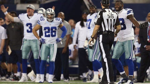 1/4 headline: Referees pick up flag in Lions-Cowboys game, set off uproar