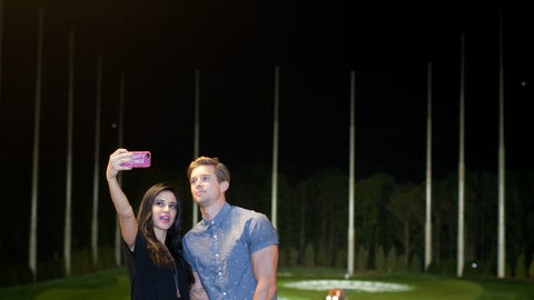 Edy Ganem and Drew Van Acker at the Topgolf
