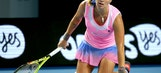 The Latest: Tsonga comes to aid of Australian Open ball girl