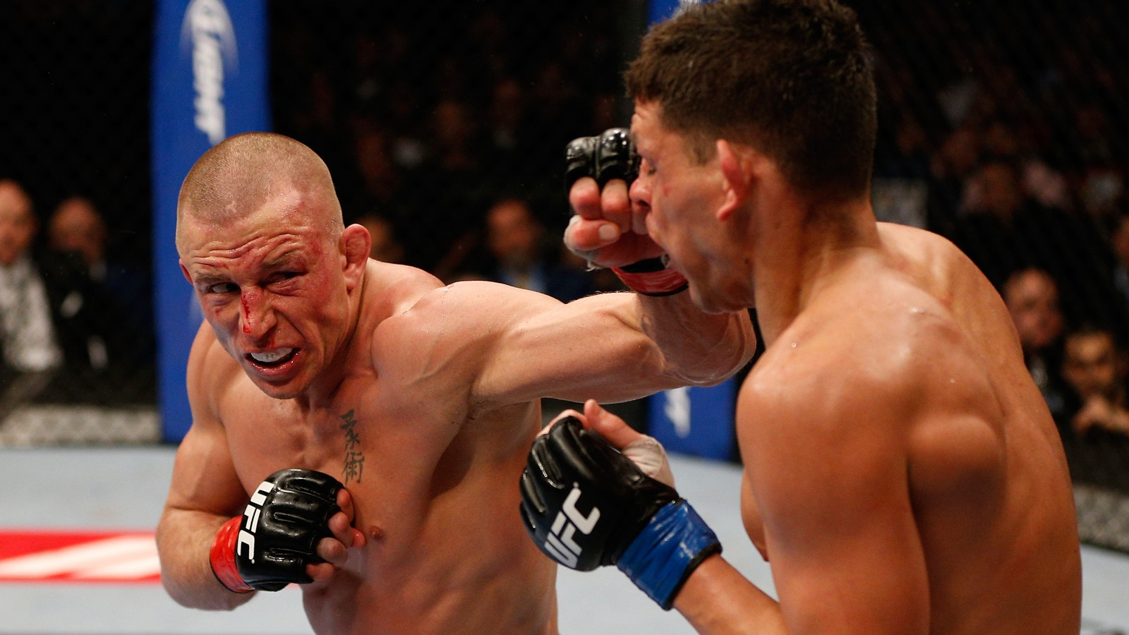Georges St-Pierre fires back at Nick Diaz, open to rematch in return