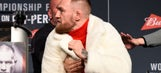 Watch: Conor McGregor nearly throws chair at Eddie Alvarez at press conference